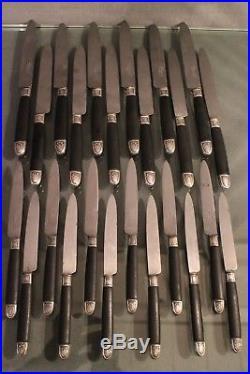 12 grands couteaux + 12 entremets manche ébène virole argent 19e style Louis 16