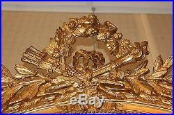 Ancien et grand miroir ovale doré de style Louis XVI époque XIX ème siècle