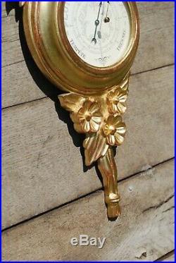 Baromètre de style Louis XVI en bois doré sculpté