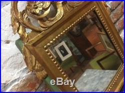 Beau miroir de style Louis XVI verre et bois doré décor d'oiseau et flambeau