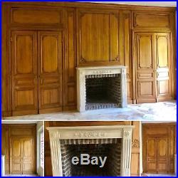 Boiserie de style louis XVI en bois clair finement sculpté. XX siècle