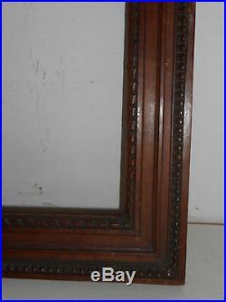 Cadre ancien en bois naturel. Noyer. Style Louis XVI