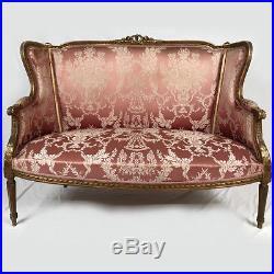 Canapé à oreilles de style Louis XVI bois doré. XIXe