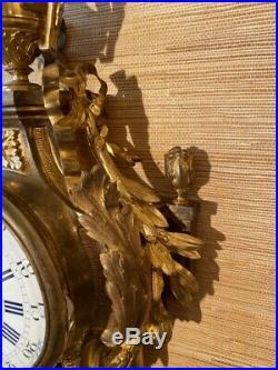 Cartel d'applique pendule en bronze doré style Louis XVI