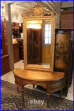Console demi-lune avec miroir en bois doré de style Louis XVI