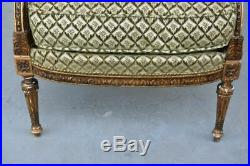 Fauteuil bergère de style Louis XVI dorée fin XIXème