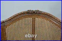 Fauteuil double cannage de style Louis XVI en merisier vers 1900 (paire)