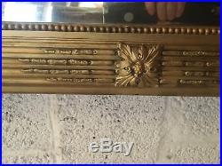 Glace de style Louis XVI en bois et stuc doré / Miroir / Trumeau