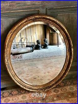 Glace / miroir ovale style Louis XVI patiné doré
