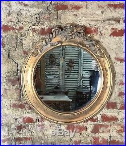 Glace / miroir rond style Louis XVI à décors de roses bois et stuc patiné doré