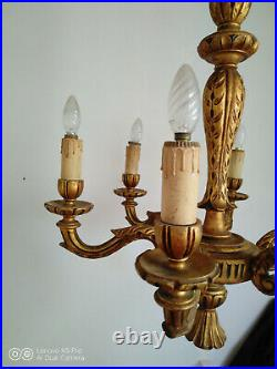 Grand lustre en bois sculpté doré style Louis XVI