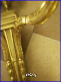 Magnifique paire d'appliques flambeau bronze style Louis XVI