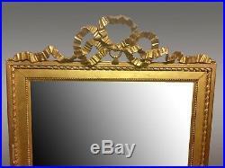 Miroir doré style Louis XVI fronton ruban