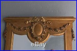 Miroir en bois et stuc doré d'époque XIXème de style Louis XVI