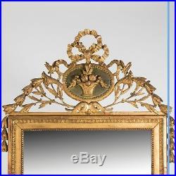 Miroir style Louis XVI en bois et stuc doré, XIXe