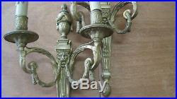 Paire d'applique en bronze style Louis XVI aux mufles de Lion d'aprés Delafosse