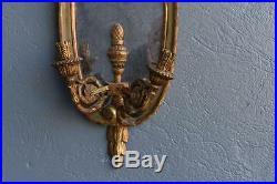 Paire d'appliques miroir 2 feux en bois doré et laqué de style Louis XVI