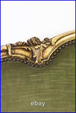 Paire de bergères basses style Louis XVI en bois doré, circa 1880