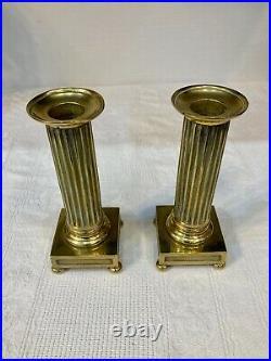 Paire de bougeoirs à la financière en bronze doré. Style Louis XVI. Début XIXème