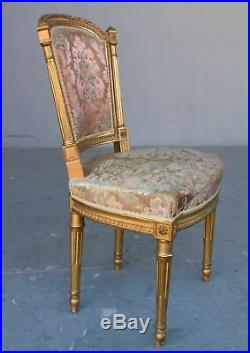 Paire de chaises style Louis XVI laquées dorées XIXème