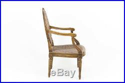 Paire de fauteuils cannés de style Louis XVI en noyer, XIXe siècle
