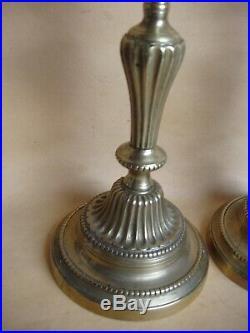 Paire de flambeaux en bronze ciselé de style Louis XVI début du XIXe siècle