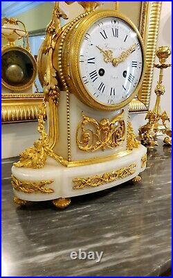 Pendule Borne style Louis XVI en bronze doré et Onyx blanc sgn RAINGO FRERES XIX