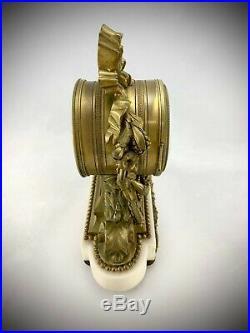 Pendule complète en bronze doré sur socle marbre style Louis XVI
