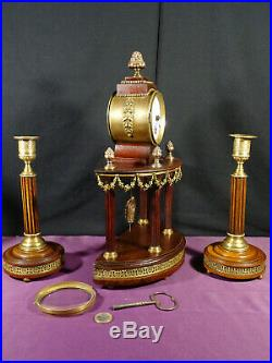 Pendule de cheminée avec ses bougeoirs XIXé style Louis XVI bois et laiton