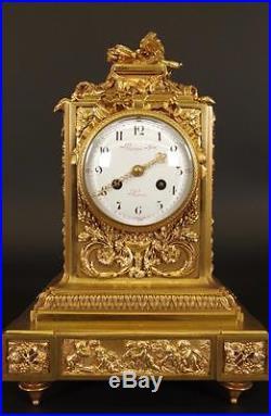 Pendule en bronze doré style Louis XVI par Raingo