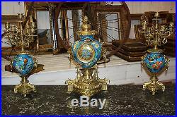 Pendule / garniture de cheminée en faïence et bronze de style Louis XVI