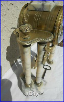 Pendule portique a colonne MARBRE ET BRONZE style LOUIS XVI