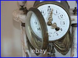 Pendule portique marbre et bronze style Louis XVI