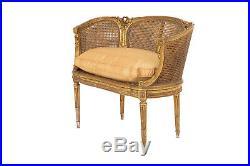 Petit canapé canné style Louis XVI en bois doré, vers 1880