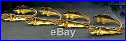 Série de 4 embrasses de rideaux, bronze doré XIXe, style Louis XVI, patère