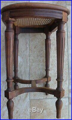 Siège / tabouret de piano en bois & cannage vers 1900 de style Louis XVI