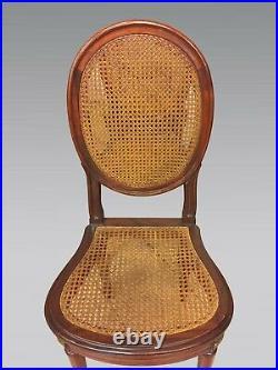 Six chaises cannées style Louis XVI acajou