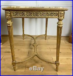 TABLE DE MILIEU EN BOIS DORÉ DU 19e DE STYLE LOUIS XVI AVEC DESSUS MARBRE
