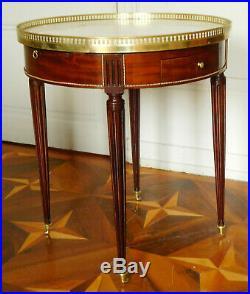 Table bouillotte de style Louis XVI en ACAJOU et BRONZE DORE, époque XIXe siècle
