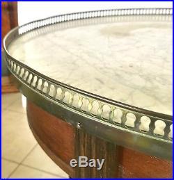 Table bouillotte style louis XVI dessus marbre blanc galerie bronze. XIX siècle