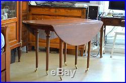 Table style Louis XVI en acajou massif, 6 pieds fuselés 2 allonges 19è siècle