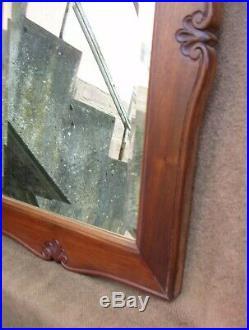 Très beau ancien miroir en noyer de style Louis XVI début XXe siècle
