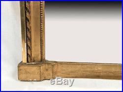 Trumeau de style Louis XVI. Bois et stuc doré